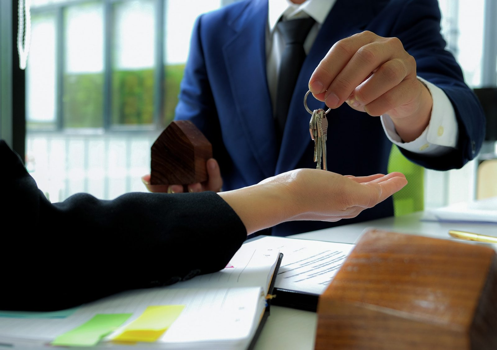 Home sales broker closes the sale and sends key to the customer.